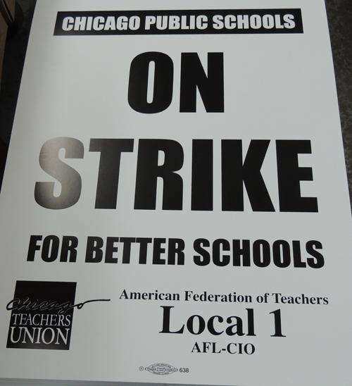 Photo of On Strike signs rolling off the presses