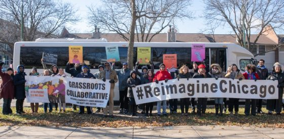 Photo: Bus tour participants in front of bus with Grassroots Collaborative banners hash tag Reimagine Chicago