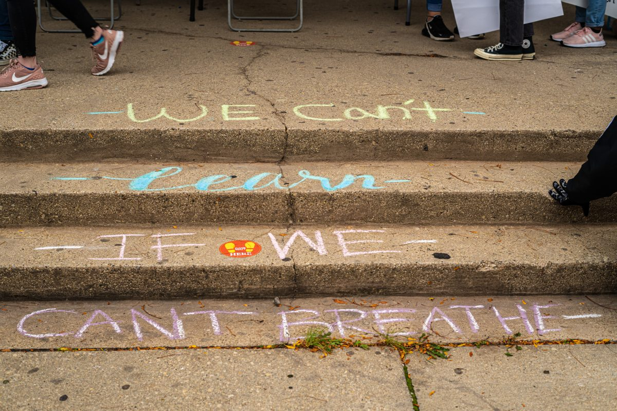 We can't learn if we can't breathe, says chalk drawing on school steps